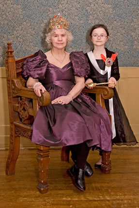 A grandmother and her granddaughter pose with their crown jewels